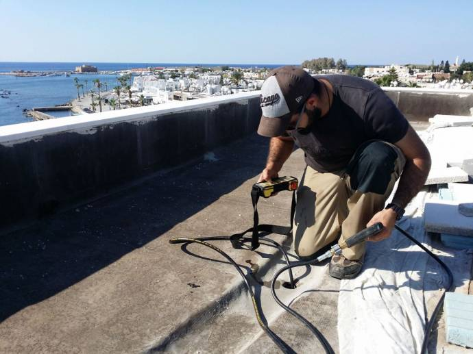 Tasos is using the Riomote controller to control the MultiJet from the roof of a hotel in Paphos